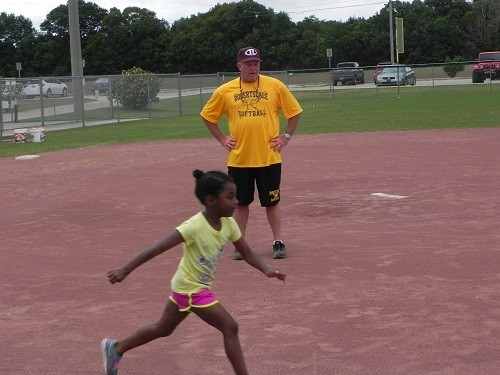 RHS head softball Coach Barry Roberts oversees base running drills during the free city camp held this past week.