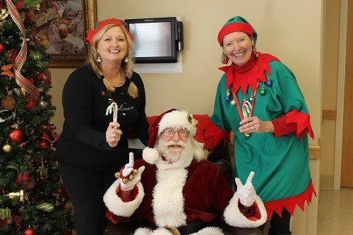 The Blake at Malbis Outreach Coordinator Susan Cox, left, and Robertsdale Rehabilitation & HealthCare Center Administrator Mary Kay Polys with Santa.