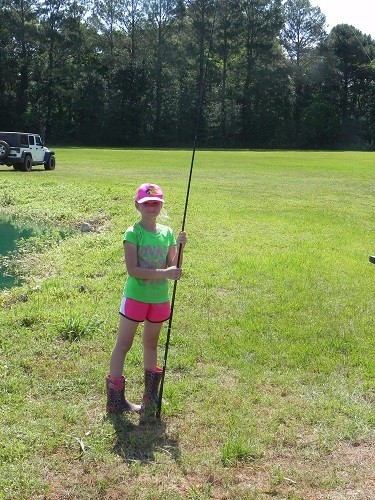 Elizabeth D'Olive, 9, of Spanish Fort takes a break from fishing on Saturday, May 12 in Loxley.