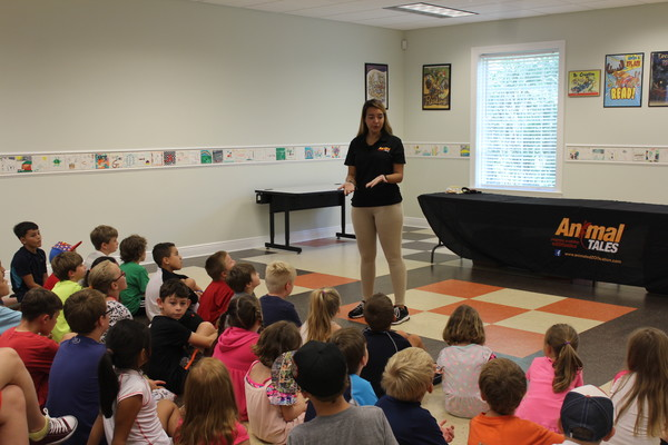 """The Animal Tales """"Libraries Rock"""" show was hosted by Animal Tales' Miss Vicki, who visited the Marjorie Younce Snook Public Library in Summerdale on Tuesday, June 19, and brought along an assortment of animals for the children to see and interact with."""