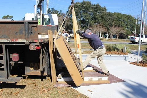Stan Vinson of Mack Funeral Home Monuments in Robertsdale and James McKinley of Parkway Enterprises of Perdido work Wednesday to place the first of three stones honoring all veterans from Silverhill and the surround areas at the Silverhill Veterans War Memorial in Silverhill.