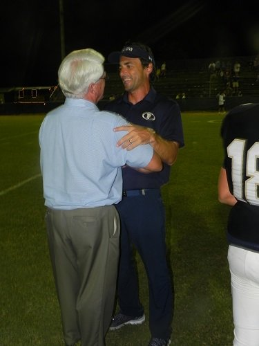 Tad Niblett embraces legendary Foley coach Lester Smith following his home opener with the Lions in 2015.