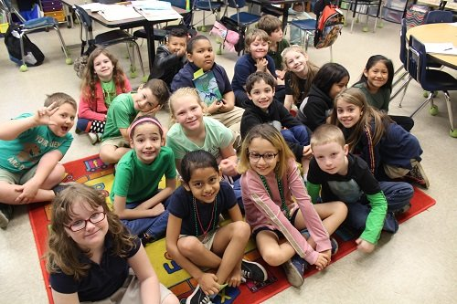 """Second grade students in Amy Thomley's class at Silverhill School got a visit from Onlooker co-editor John Underwood on Wednesday, March 4 as part of Read Across America Day. Underwood talked about his job and read """"The Cat in The Hat"""" to the students."""