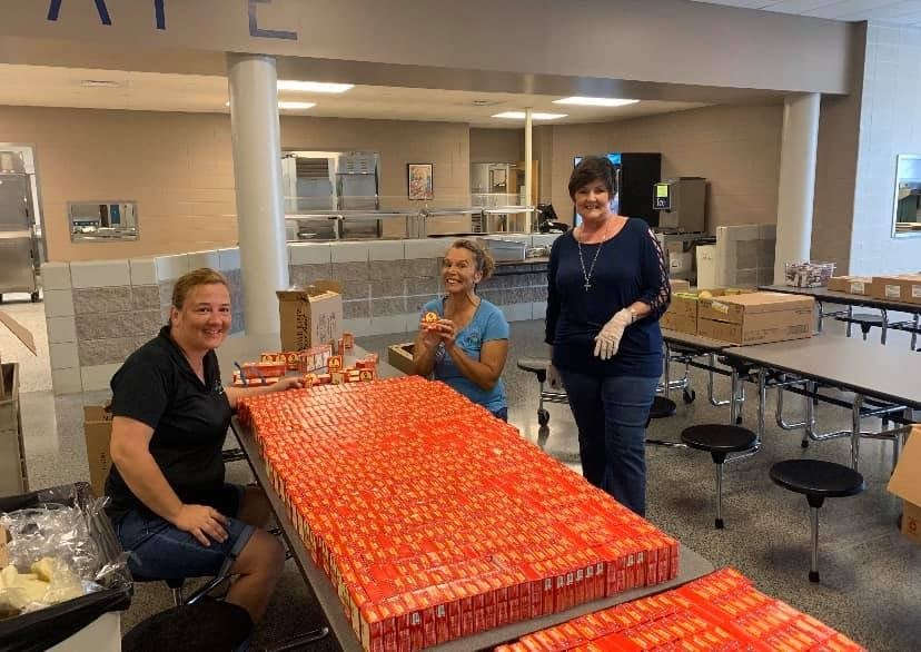 "LuLu's Gulf Shores sent volunteers and food to help Gulf Shores City Schools provide ""Grab and Go"" meals for students and any child under the age of 18."