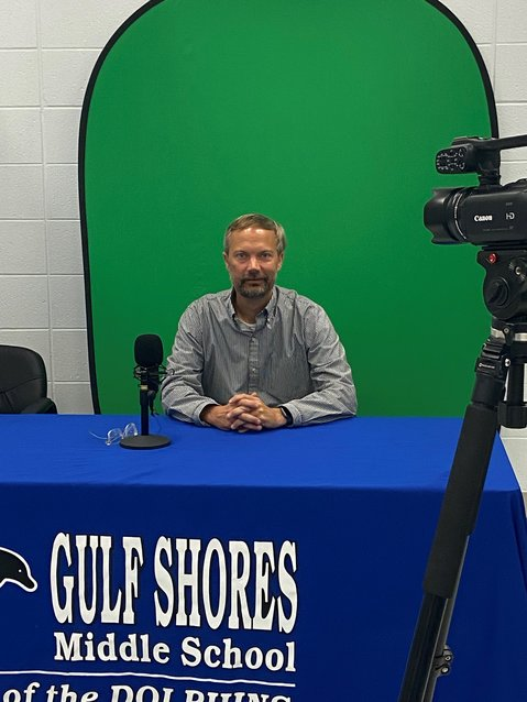 Gulf Shores Middle School principal, Robert McCartney gets ready for his daily Distance Learning broadcast.
