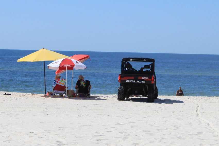 Gulf Shores Rescue and Police patrol the beach Saturday to ensure beach goers maintain 6-foot distance and groups of 10 or less.
