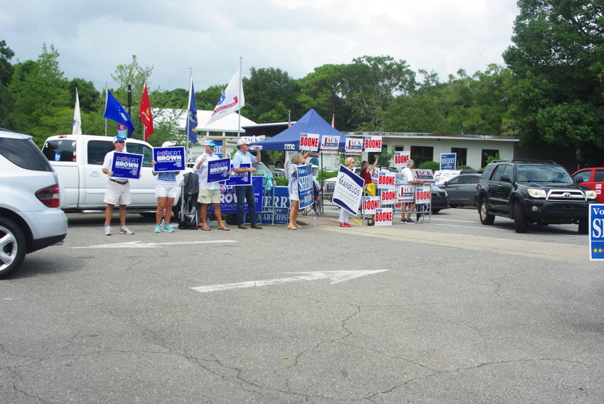 Candidate supporters greet voters at the Fairhope Civic Center during elections on Aug. 25.