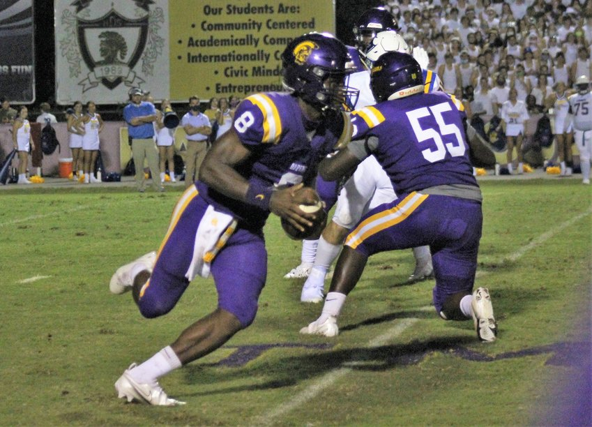 DHS quarterback Trent Battle in action at Jubilee Stadium.