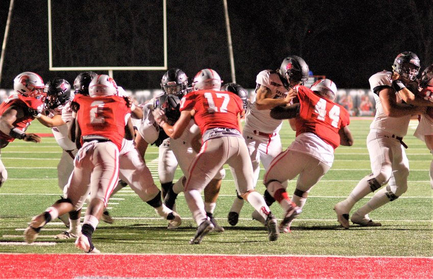 CRUNCH TIME - The Toros' offensive line makes way for an SF touchdown at Saraland.