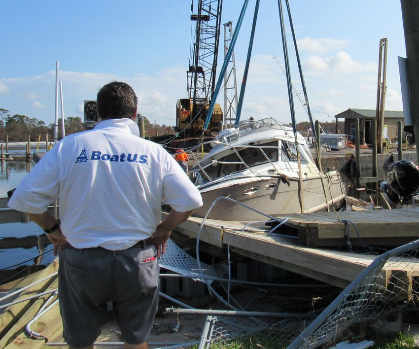 The GEICO BoatUS Marine Insurance Catastrophe Team recovers an insured's vessel at the Oyster Bar Marina in Pensacola, Florida.