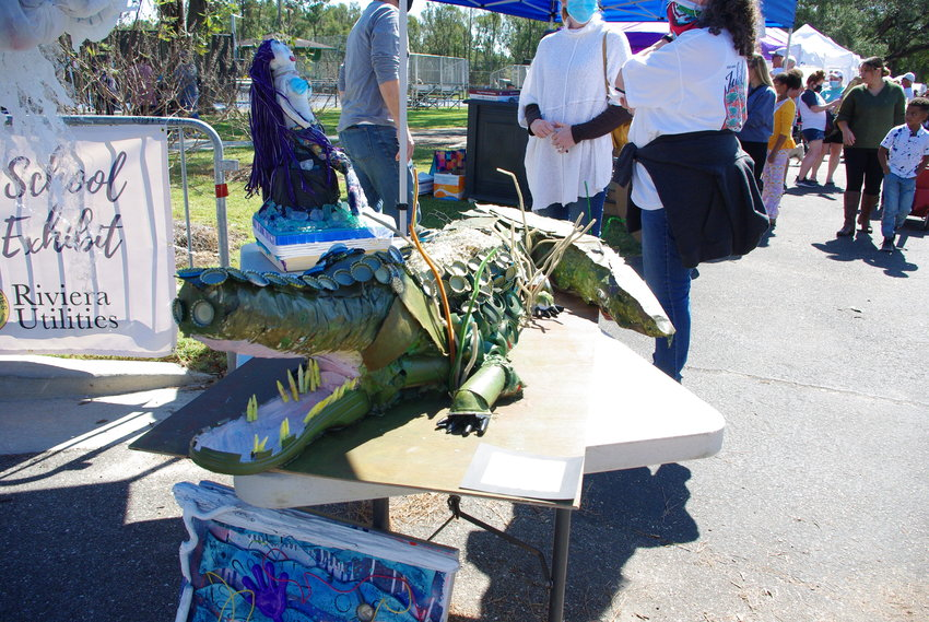 An alligator made from trash found on the beach was part of a high school environmental art exhibit.