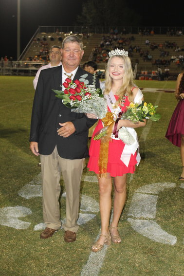 2020 RHS Homecoming Queen Maddie Cooper poses with her father following halftime ceremonies Friday night at J.D. Sellars Stadium.