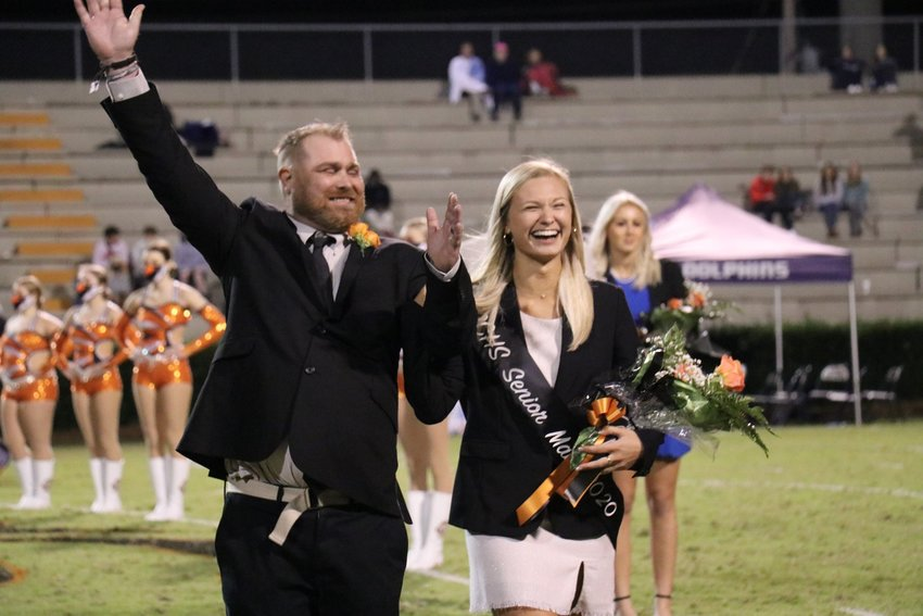 Baldwin County High School Homecoming Queen Samantha Rogers celebrates with her father Shawn Rogers.