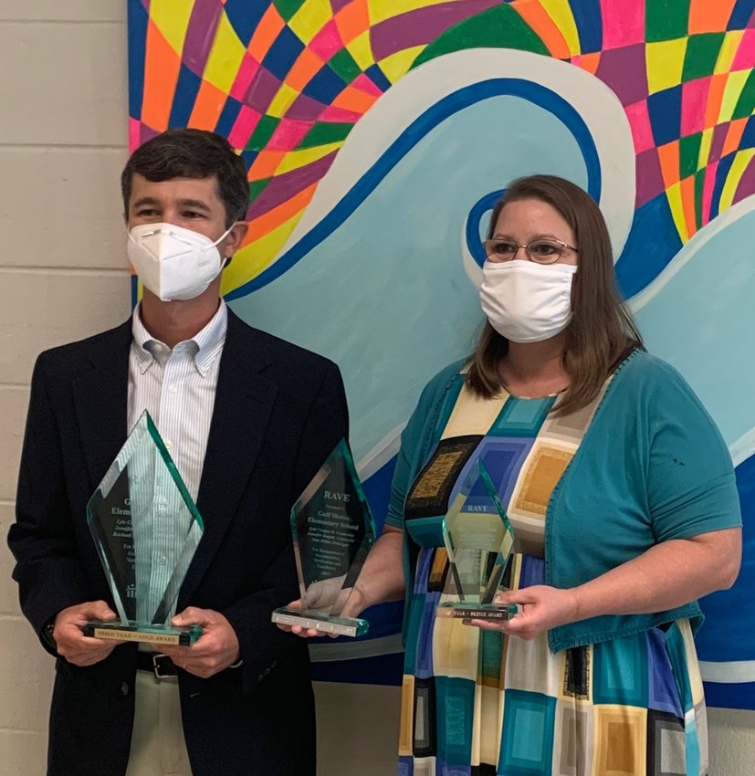 (from left) Gulf Shores Elementary School counselors Lyle Cooper II and Jennifer Knight except the RAVE Award.