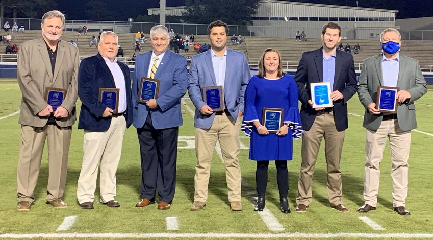 Fairhope HOF Class of 2020:from left, Bob Baumhower, Andy Penry, Erik Cortinas, Daryl Norris, Stephanie Dunaway Bell, Nathan Haywood and standing in for Michael Ulmer, Fairhope High principal Jon Cardwell.
