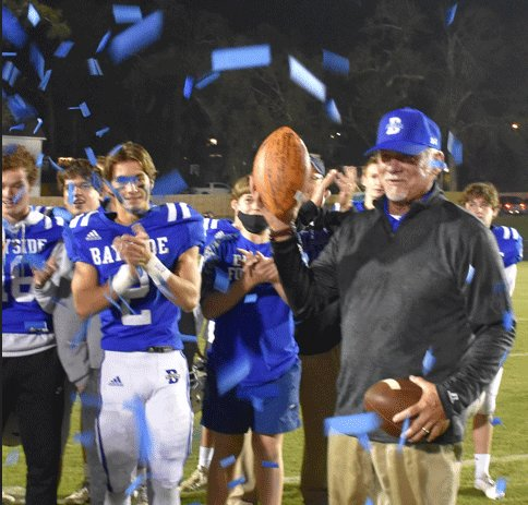 Admirals present 100th victory game ball to head coach Phil Lazenby at Freedom Field Oct. 30, 2020.
