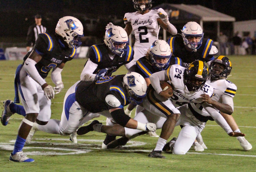 Pirate defenders swarm to the ball against Murphy in their last regular season game of 2020.