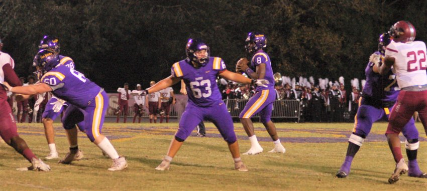 The Daphne offensive line give quarterback Trent Battle time against Prattville rushers at Jubilee Stadium in Class 7A round-one playoff action Nov. 6.