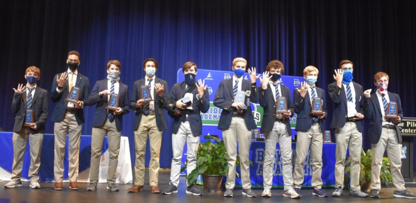 Bayside Academy state champion indoor track and field team members show off their rings, Nov. 12. From left: Joe Howell, Myles Cook, Jay Loper, Gerrit Robbins, Ryan McCullough, Trey McKean, John Thomas Neill, Ty Postle, Patrick Daves, and Angus Ladd.