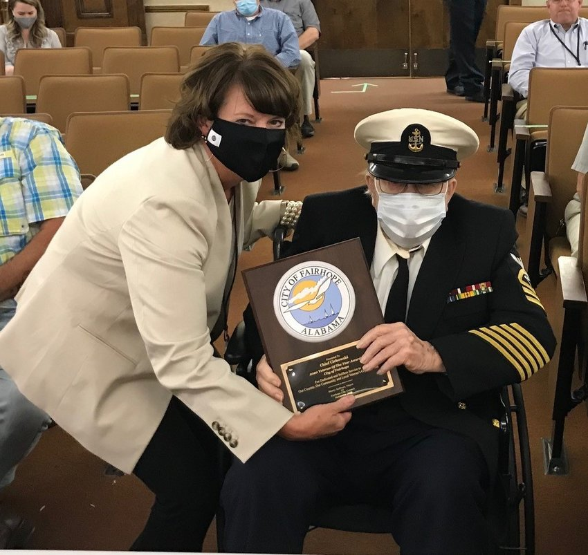 """Fairhope Mayor Sherry Sullivan presented Harry """"Chief"""" Cichowski with the 2020 Veteran of the Year award. Cichowski, a 30-year Navy veteran, has lived in Fairhope for more than 50 years."""