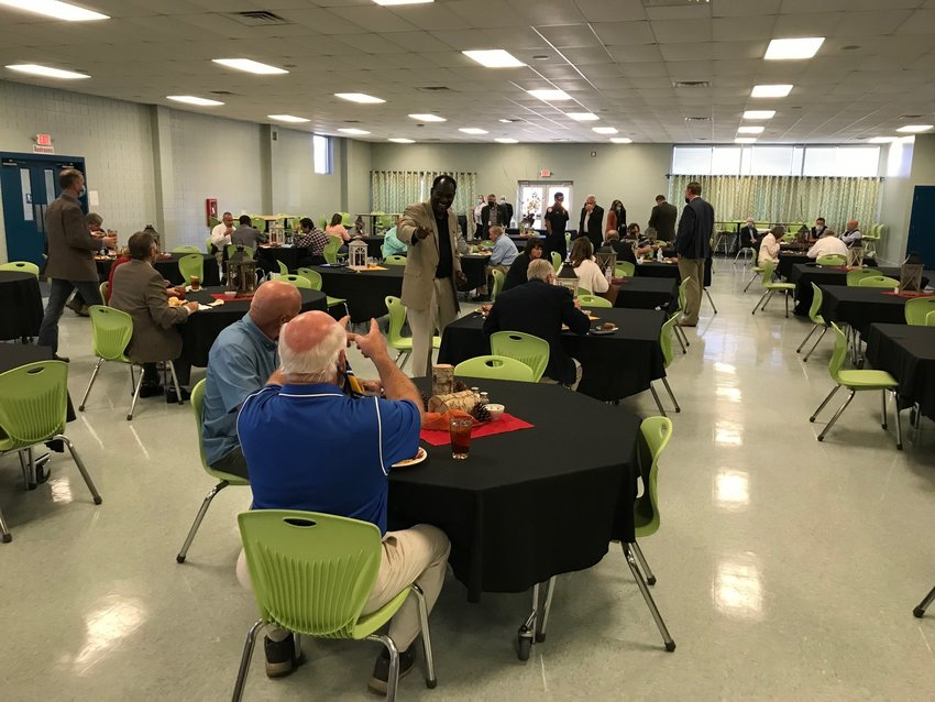 Local officials take part in a lunch meeting with Superintendent of Education Eddie Tyler.