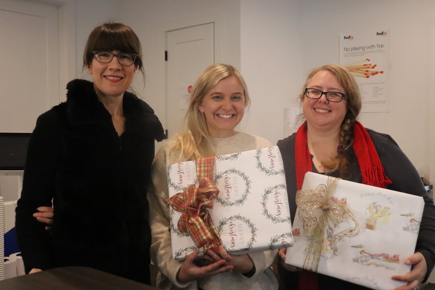 Julie Comer, Grace Horne and Jamie Hadden craft custom gift wrapping for artists and families.
