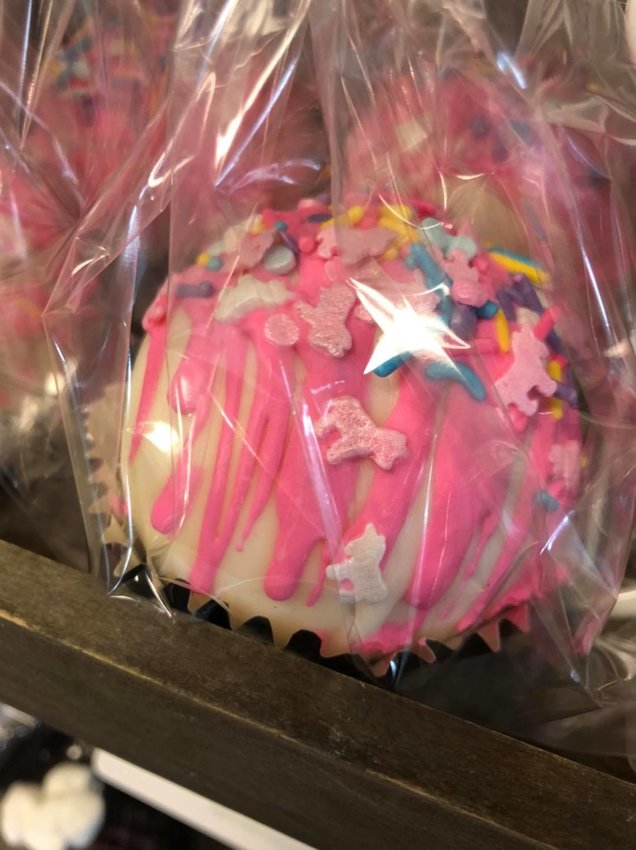 Sugar House Custom Cakes in Fairhope has hot chocolate bombs in store every day, but they go quick so get there early. They make a variety of flavors too like this strawberry unicorn.