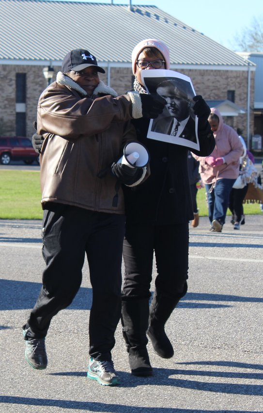 Participants with the Loxley Area Martin Luther King Group march up Alabama 59 (Hickory Street) last year.