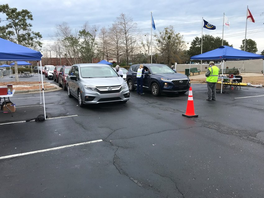 Cars line up at the Daphne Civic Center during the COVID-19 vaccination clinic.