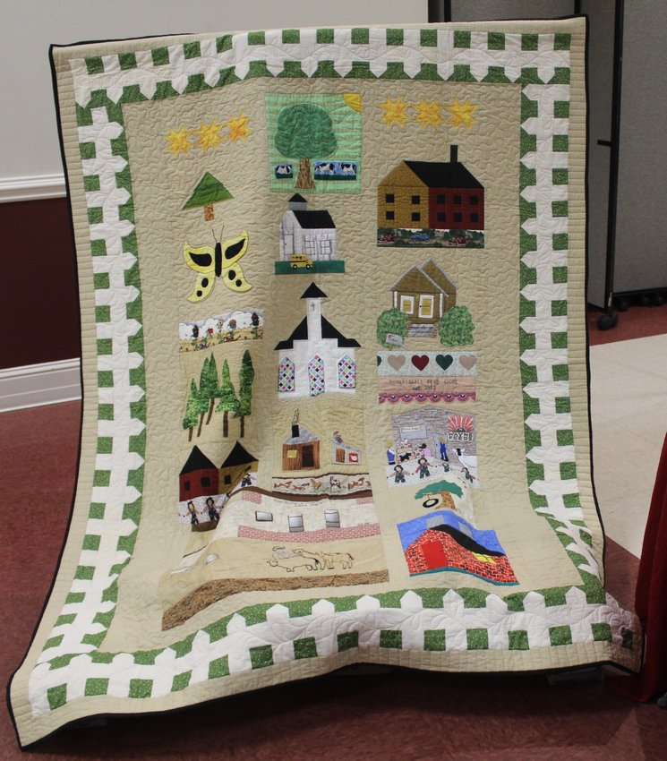 This quilt, donated by Ye Ole Ladies Quilting Circle, is being raffled off to raise funds for Robertsdale High School Alumni Association scholarships. The quilt celebrates the 100th anniversary of Robertsdale. The drawing will be held Saturday, Feb. 27, the day the annual RHS Alumni Association Tea was scheduled to be held. The event has been canceled because of Coronavirus concerns.