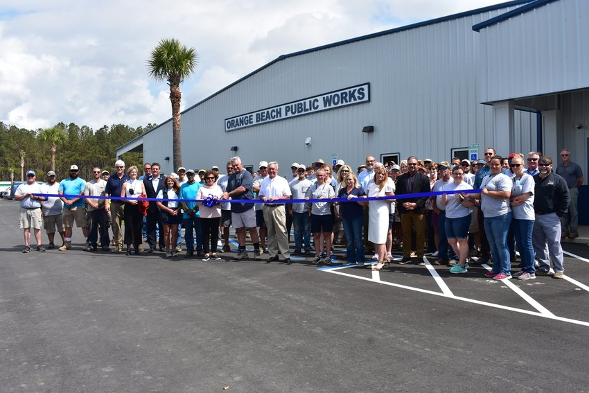 Orange Beach City officials, department heads and staff gathered March 16 to cut the ribbon on the new Public Works building after a year of construction.