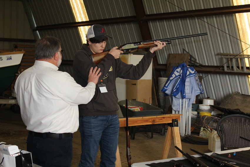 Tony Landenwich of Southeastern Defensive Firearms Training gives a safety demonstration Saturday, March 20 at Mullek Farms in Rosinton.