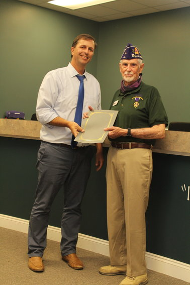 Silverhill Mayor Jared Lyles presents a proclamation honoring resident Ed Evans at the Silverhill Town Council meeting Monday, April 5. Evans will represent the state of Alabama at the 2021 Purple Heart Patriot Project which will be held in New York in September.