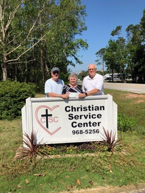 Pictured (From left)Stan Moss, CSC Food Pantry chairperson; Linda Chappelle, CSC Board President/Center Director; Herb Malone, Erie Hall Meyer Charitable Fund chairperson.