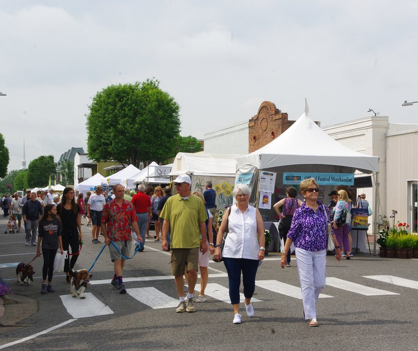 Visitors to the Fairhope Arts and Crafts Festival walk past booths on Section Street.