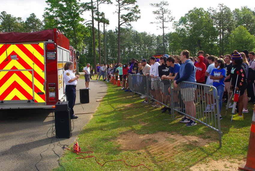 Daphne Fire Chief LeAnn Tacon speaks to Daphne High School students during a simulation of a distracted driving accident on the school campus Thursday morning.