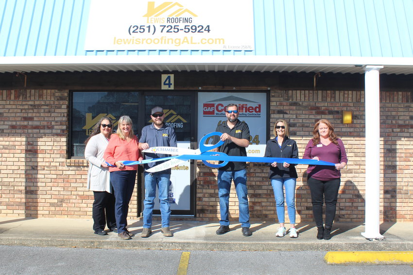 Officials with the Central Baldwin Chamber of Commerce held a ribbon cutting on Thursday, April 22 at Lewis Roofing in Robertsdale. Pictured with Chamber officials are owner Darrell Lewis and associate Jasper Klinger.
