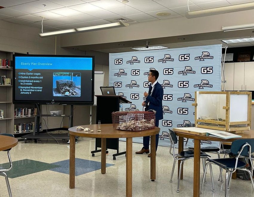 Andrew Meza presents his Capstone Project to members of the community.