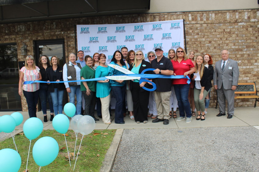 Family, friends, colleagues and members of the community joined owners Courtney and Phil Cathers to cut the ribbon Friday, April 23 with the Central Baldwin Chamber of Commerce at Exit Navigator Realty in Robertsdale.