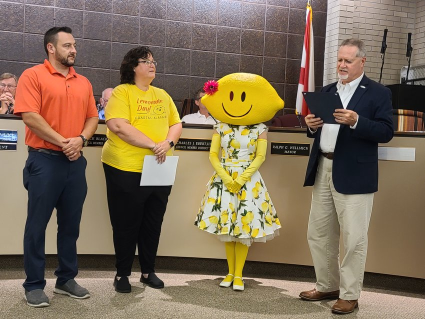 From left, South Baldwin Chamber Vice President of Investor Relations Travis Valentine, Coastal Alabama Business Chamber VP of Education & Programs Penny Hughey, Lemonade Day Mascot Zesty, and Foley Mayor Ralph Hellmich.