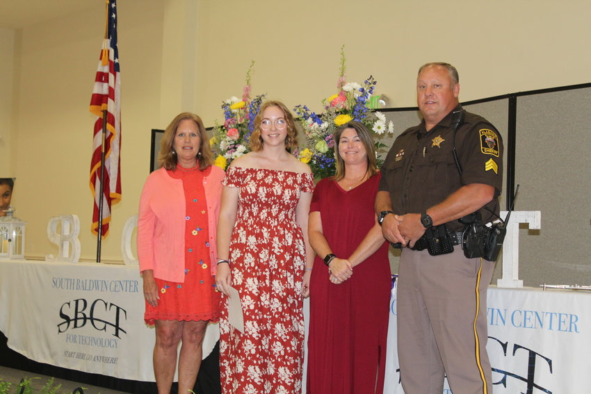 Presenting the $2,500 Garrett Phillips Memorial Voactional Scholarship to Abbiegail Kennard, second from left, are Central Baldwin Sunset Rotary scholarship chair Peggy Nelson, and Garrett's parents, Amy and Randy Younce. Scholarship recipients were announced by Sheriff Huey Hoss Mack.