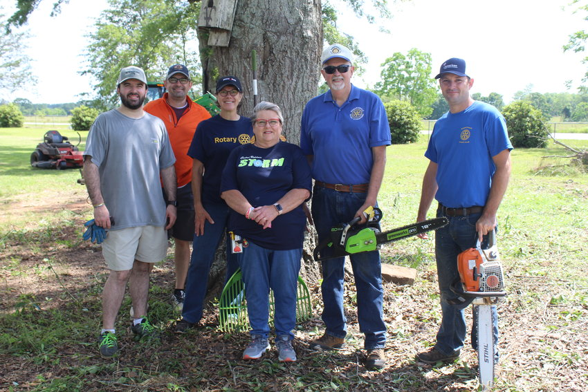 Members of the Robertsdale Rotary Club served as clean-up crew on Saturday, May 15 at the home of Bobbie Beverly in the Elsanor community. Pictured with  Beverly, center, are Rotary Club 2020-21 President David Kitchens, past president Sean McClay, incoming president for 2021-22 Rebecca Mills, Robertsdale Rotary Foundation Board President Doug Byrd and incoming president for 2022-23 Ryan Frolik.