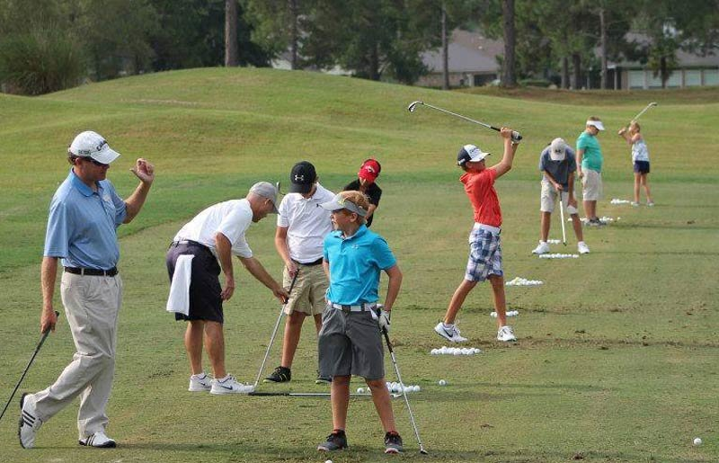 PGA Professional David Musial works with student golfers on approach shot technique.