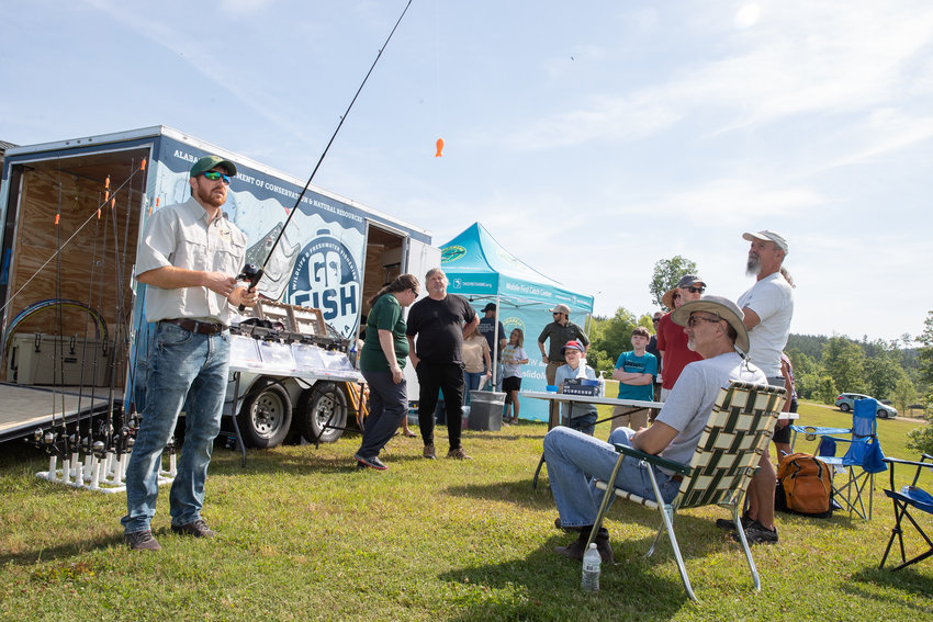 Nathan Aycock of the Alabama Wildlife and Freshwater Fisheries Division demonstrates casting techniques to attendees at the Go Fish, Alabama! event at Bibb County Lake.
