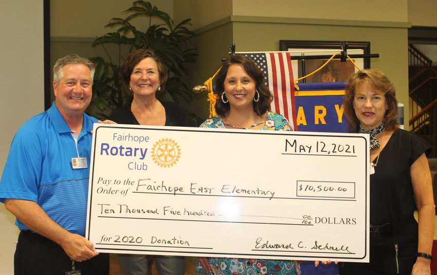 Fairhope East Elementary (from left): Edward Schnell, president of the Rotary Club of Fairhope; Carol Broughton, FEE principal; Christina Stacey, FEE assistant principal; Poenta Luckie, 2019–2020 president, Rotary Club of Fairhope.