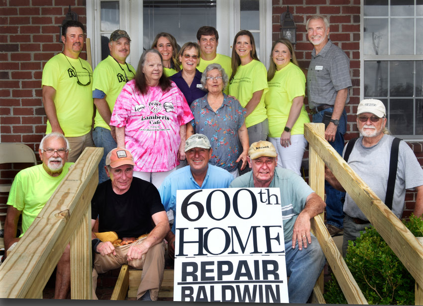 Back row, members of the Baldwin County Home Builders Charitable Foundation, from left: Chris Farlow, Brian Armstrong, Alex Cary, Jeff Frostholm, Nancy Grace, Marsha Jordan, and Repair Baldwin Coordinator Steve Riggs.  In middle, homeowner Judith Gibson, EMI Executive Director Sally Deane, and Imogene Little.  Front row, Eastern Shore Baptist Volunteers, from left: Ron Padgett, Lloyd Busbee, Rick Reymolds, Don Smith, and Wayne Sanders.