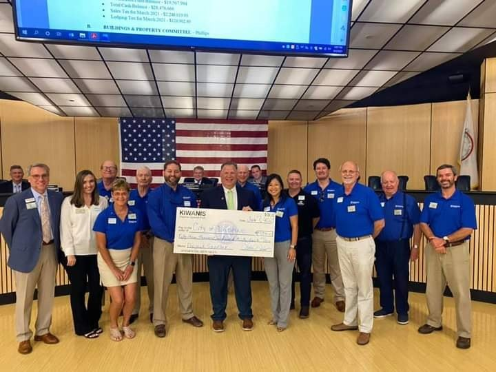 Project Sandbox supporters present a $53,000 check to the Daphne City Council.