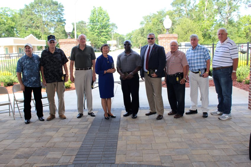 Bibles were awarded to 14 veterans in Robertsdale on Monday, May 31 as part of the city's Memorial Day remembrance at the Honeybee Park pavilion. Pictured are, from left, Morrell H. Yates, James E. Patterson, Larry D. Lewis, guest speaker retired Maj. Gen. Janet Cobb, Maurice Wiley Sr., Larry W. Roberts, Elmer G. McDaniel, Walter Lowery, John M. Phillips Jr.; not pictured, Neal Dickinson, Clyde Myrick III, Clyde Payne, Tedd A. Stone and Fred L. Stringer IV.