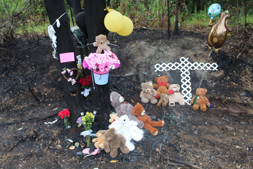 Memorials mark the spot where two teens died in a single-vehicle accident last weekend off County Road 64 in Rosinton.