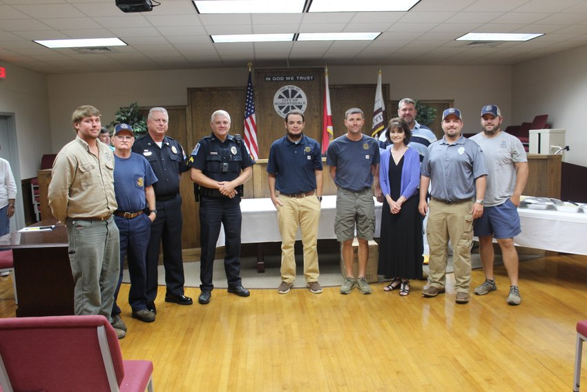 Employees with the city of Robertsdale received longevity awards following the city council meeting June 21, including, pictured from left, Austin Wallace, Mike Smith, Heath Brill, Thomas Kiel, Tony Kollins, Justen Tuberville, Susan Mitchell, Neal Dickinson, Seth Thomley, Tres Givens; not pictured Michelle Stewart, Jacob Powell and Fred Stringer.